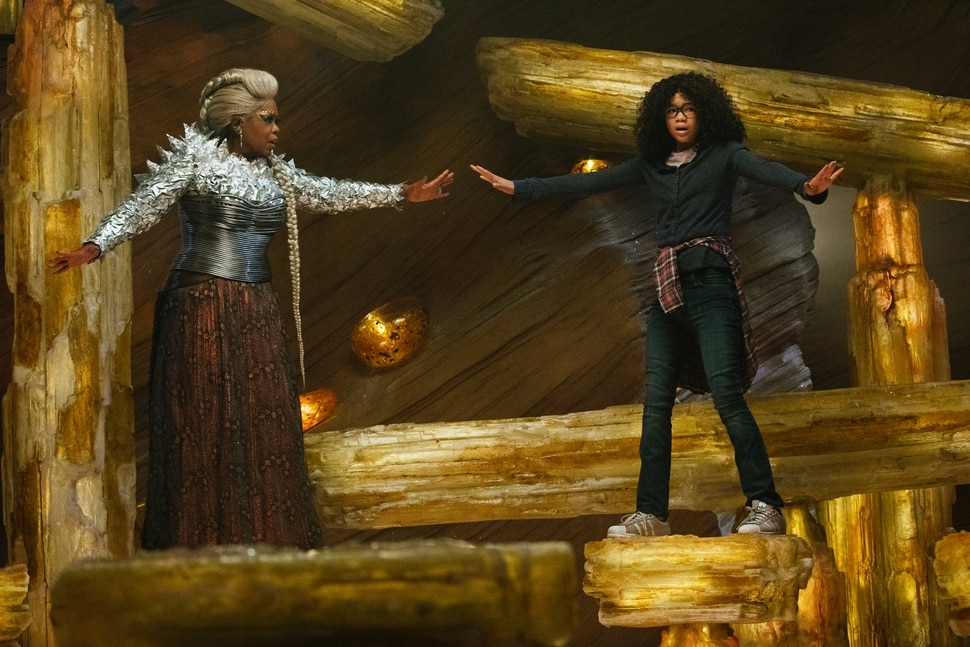 (courtesy Walt Disney Pictures) Meg Murry (Storm Reid, right) tries to keep her balance, with support from the imperious Mrs. Which (Oprah Winfrey), in director Ava DuVernay's adaptation of A Wrinkle in Time.