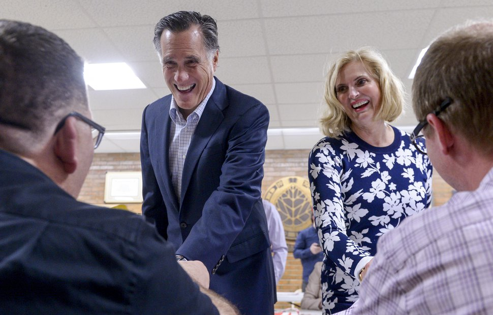 (Leah Hogsten | The Salt Lake Tribune) Mitt and Ann Romney share a laugh with caucus workers. The Romneys attended their local caucus meeting with other members of the Holladay Precinct 23. A combined 35 caucuses held opening ceremonies together at Cottonwood High School Tuesday, March 20, 2018.