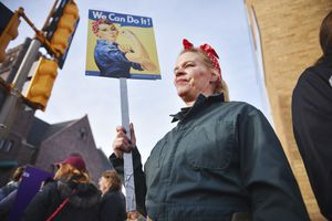 "(Briana Sanchez | The Argus Leader via AP file photo)  Sheila Dathe wears a ""Rosie the Riveter"" inspired work uniform to the Women's March Saturday, Jan. 20, 2018 in downtown Sioux Falls, S.D. The march is among dozens of rallies being held around the country. The activists are hoping to create an enduring political movement that will elect more women to government office."