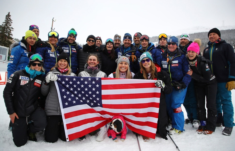 Third placed United States' Lindsey Vonn celebrates with her team in the finish area after the women's downhill race, at the alpine ski World Championships in Are, Sweden, Sunday, Feb. 10, 2019. (AP Photo/Marco Trovati)