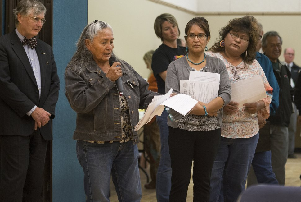 FILE - In this Nov. 16, 2017, file photo, Louise Rock, from the Oljato chapter of the Navajo Nation speaks at a hearing in Bluff, Utah. Navajos who once worried they'd have to drive hours to cast their ballots in Utah say a new settlement is a step forward as tribes challenge what they call discriminatory voting practices around the United States. The American Civil Liberties Union of Utah said Thursday, Feb. 22, 2018, the settlement that requires tribal-accessible polling places and Navajo-language help is a victory for voting rights. San Juan County, though, says they're committed to fair elections and took the steps themselves. (Leah Hogsten/The Salt Lake Tribune via AP, File)
