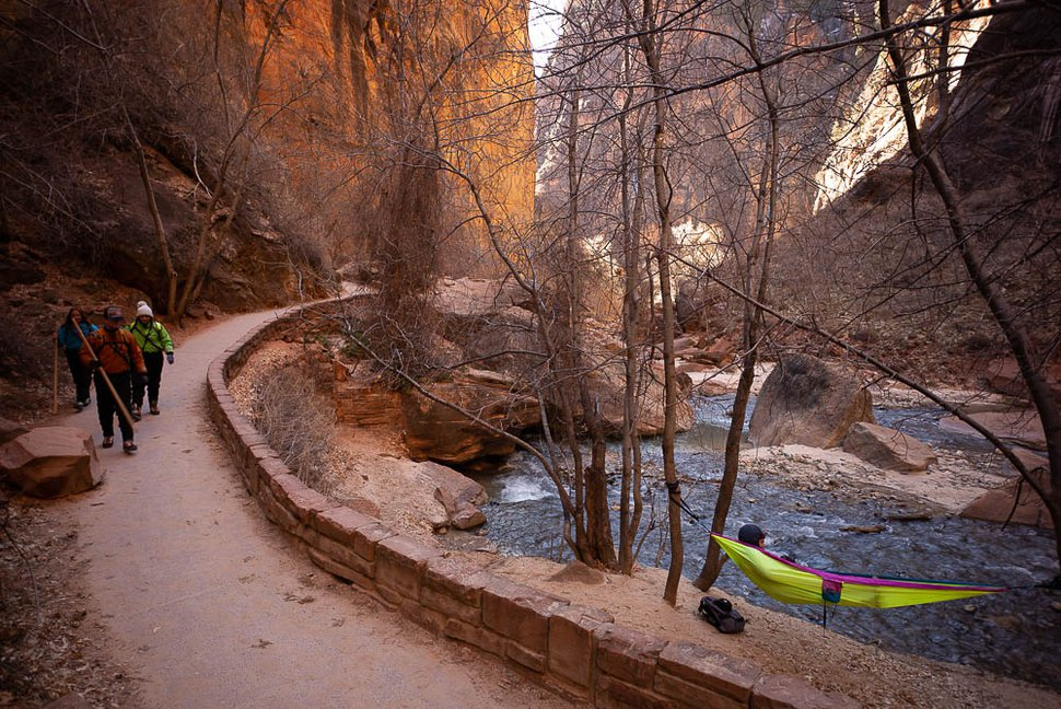 (Trent Nelson | The Salt Lake Tribune) A woman in a hammock at the end of the Riverside Walk in Zion National Park on Saturday Jan. 12, 2019.