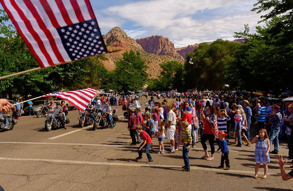 Trent Nelson | The Salt Lake Tribune Onlookers on the route as the Colorado City and Hildale Fourth of July Parade makes its way down Central Street in Hildale, Utah, and Colorado City, Ariz., Saturday July 2, 2016.