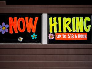 """(Trent Nelson     The Salt Lake Tribune) A now hiring sign at a Salt Lake City fast food restaurant offers """"up to $13 a hour"""" on Tuesday, July 6, 2021. Some eateries are paying even more."""