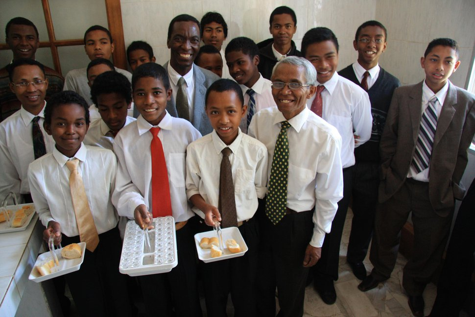 (Courtesy Photo of The Church of Jesus Christ of Latter-day Saints) Priesthood-holding Latter-day Saint boys in Africa prepare to pass the sacrament.
