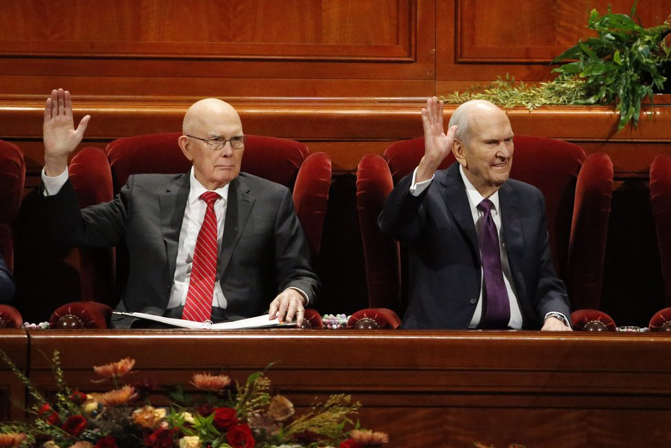 (Rick Bowmer | The Associated Press) President Russell M. Nelson, right, raises his hand during a sustaining vote with his counselor, Dallin H. Oaks, left, during The Church of Jesus Christ of Latter-day Saints' twice-annual church conference Saturday, Oct. 5, 2019, in Salt Lake City.
