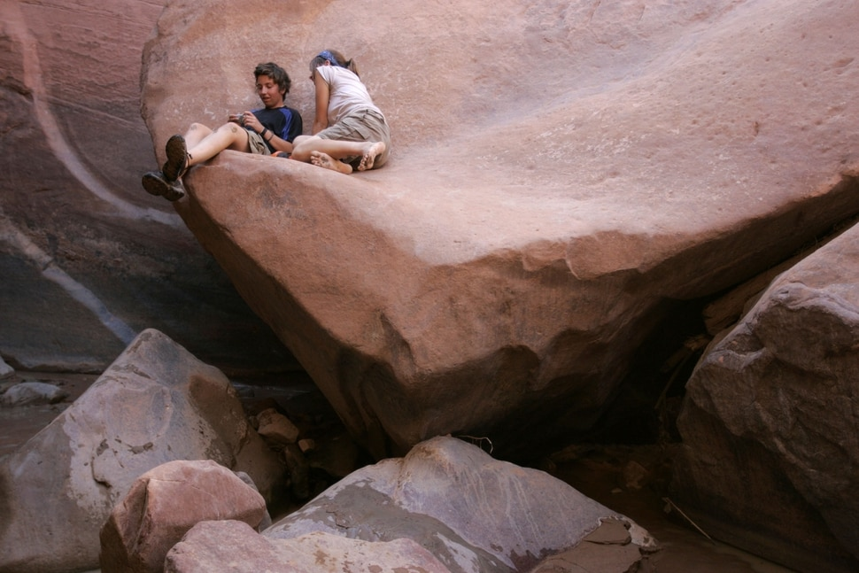 (Jim Urquhart   Tribune file photo) Aubriana Fumagali, 15, of Boca Raton, Florida, left, and Mary Baker, 15, of Washington DC., talk while resting on a ledge at the bottom of Coyote Gulch Thursday, July 31, 2008.
