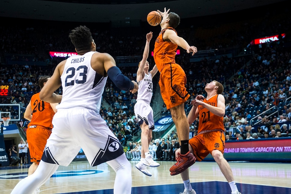 (Chris Detrick | The Salt Lake Tribune) Brigham Young Cougars guard TJ Haws (30) shoots past Idaho State Bengals center Novak Topalovic (13) and Idaho State Bengals guard Jared Stutzman (21) during the game at the Marriott Center Thursday, December 21, 2017.