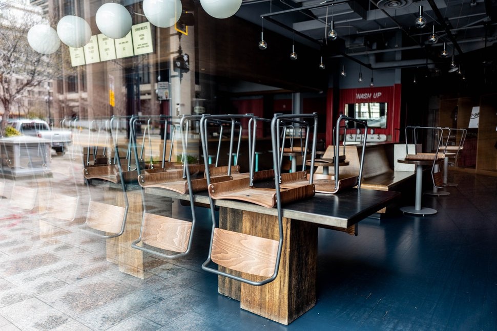 (Trent Nelson | The Salt Lake Tribune) Stacked chairs in the closed J. Dawgs Salt Lake City location on Monday, March 23, 2020.