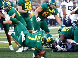 Baylor running back Abram Smith (7) dives for a touchdown against BYU during the second half of an NCAA college football game, Saturday, Oct. 16, 2021, in Waco, Texas. Baylor won 38-24. (AP Photo/Ron Jenkins)