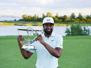 (John Minchillo   AP) Tony Finau poses with the Wanamaker Trophy after winning The Northern Trust golf tournament at Liberty National Golf Course Monday, Aug. 23, 2021, in Jersey City, N.J.