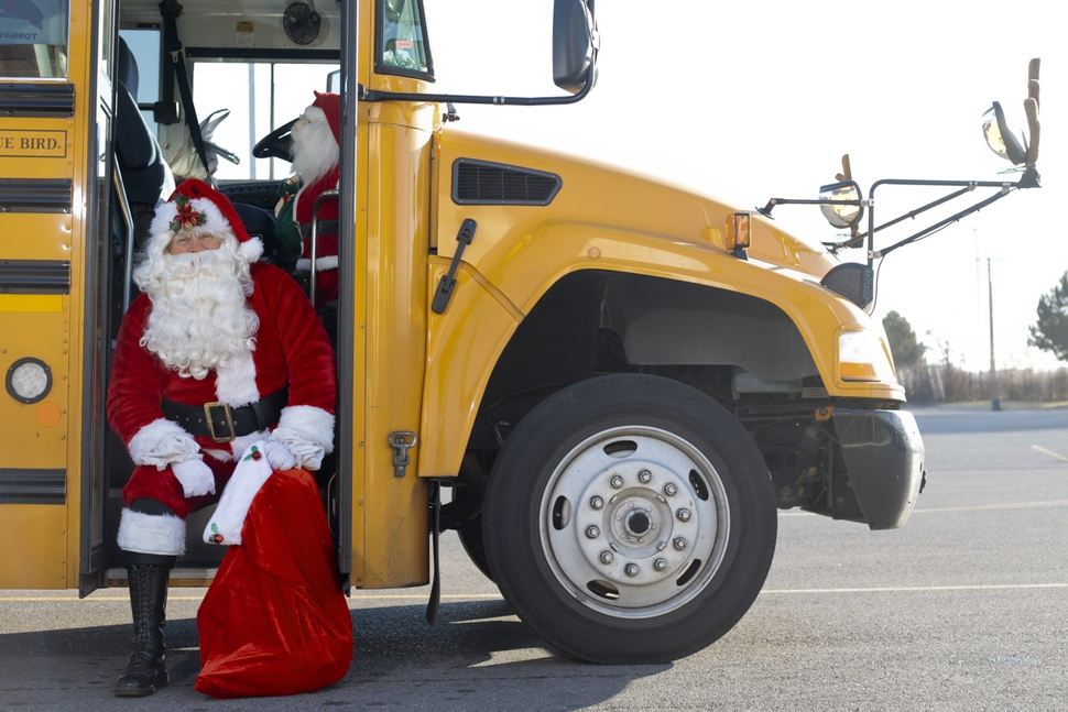Don Fitch poses for a portrait in his bus on Tuesday, Dec. 19, 2017, in American Fork, Utah. Fitch has driven school buses for the Alpine School District for the past four years. Every year around Christmas, he decorates the bus's interior with Christmas decorations, plays Christmas music and dresses up as Santa. (Evan Cobb /The Daily Herald via AP)