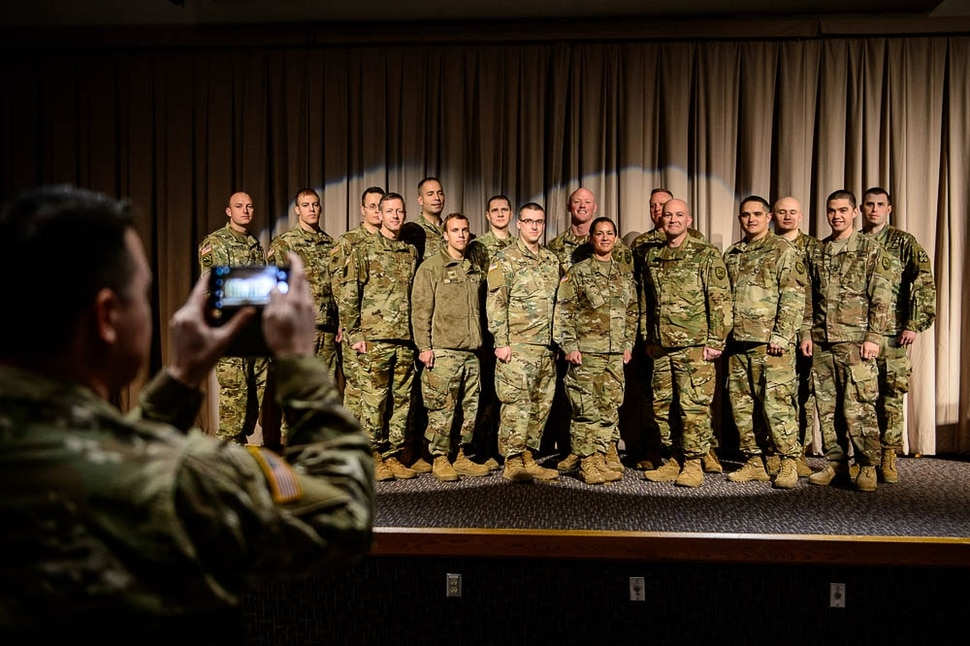 (Trent Nelson   The Salt Lake Tribune) Eighteen Utah National Guard soldiers deploying to Fort Meade, Maryland, for 400 days to conduct cyber protection operations pose for a photograph at their departure ceremony in Draper on Wednesday Jan. 2, 2019.
