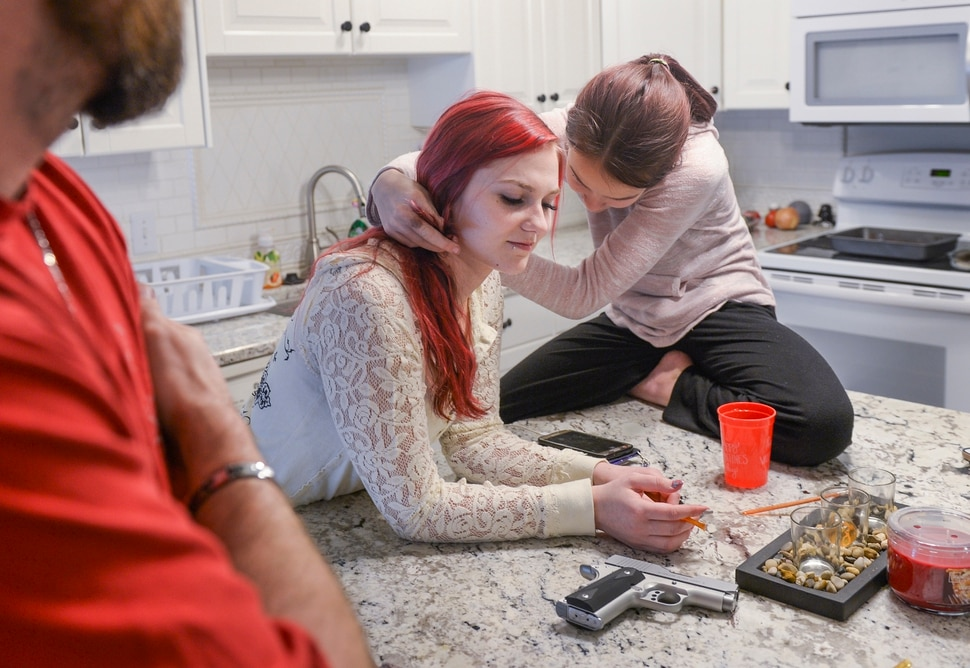 (Leah Hogsten | The Salt Lake Tribune) Jacee Cole, 20, said a stalking incident in a store as a teenager spurred her to get her concealed carry permit when she was 19 years-old for self defense. l-r Cole, shown at home with her husband, Russell Larsen, and step-daughter Katilyn, 11, Friday, March 2, 2018, now carries a Kimber .9mm pistol. I don't trust people, said Cole, who said she respects law enforcement, but questions whether the police would be able to arrive at any given situation in time to thwart a possible incident or crime. It makes me feel safe, knowing I can protect myself.
