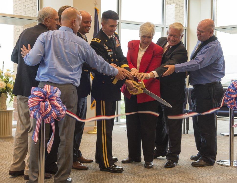 Rick Egan | The Salt Lake Tribune Adjutant General. Maj. Gen. Jefferson Burton (center) holds the scissors along with other dignitaries at the ribbon-cutting ceremony for Sunrise Hall, a newly constructed worship center at Camp Williams. Friday, August 7, 2015.