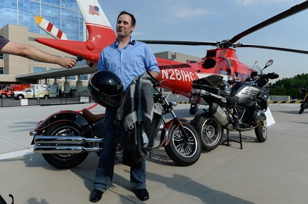 (Francisco Kjolseth | The Salt Lake Tribune) Motorcycle crash survivor Nathan Christensen holds the gear that saved his life when a driver pulled a U turn right in front of him early two years ago. Despite multiple serious injuries, Christensen has recovered. Zero Fatalities, Intermountain Medical CenterÕs Level I Trauma Program and Harrison Eurosports are encouraging motorcycle riders to wear proper safety gear. To date in Utah, there have been 18 motorcyclist deaths this year.