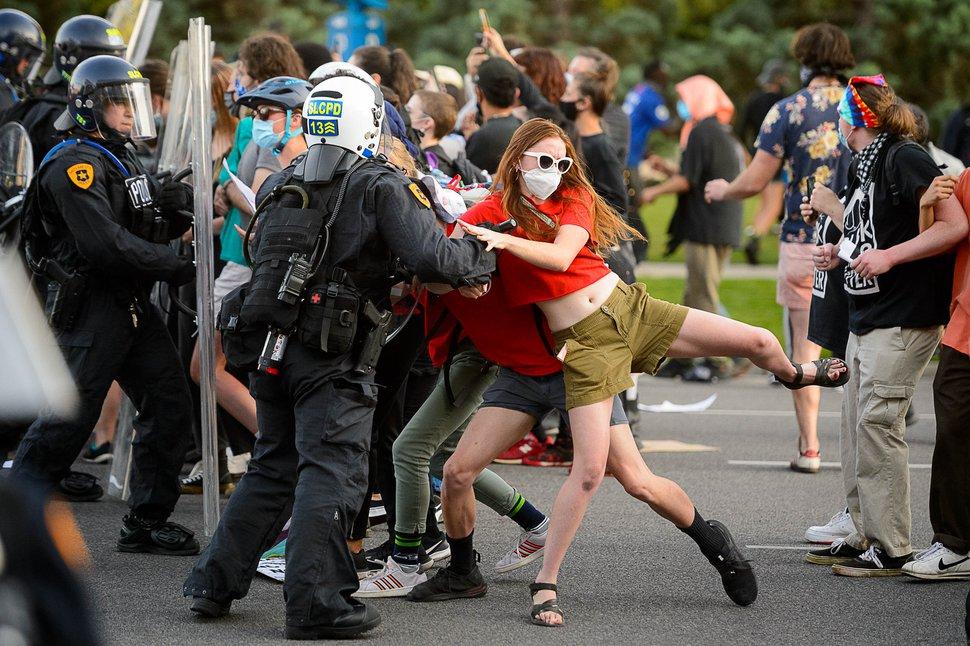 (Trent Nelson   The Salt Lake Tribune) Police push back protesters in Salt Lake City on Thursday, July 9, 2020.