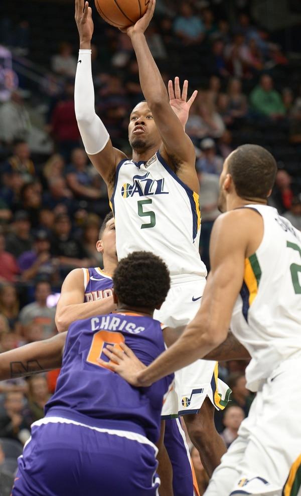 (Leah Hogsten   The Salt Lake Tribune) Utah Jazz guard Rodney Hood (5) shoots over the Phoenix defense. The Utah Jazz defeated the Phoenix Suns 112-101 during preseason NBA basketball at Vivint Smart Home Arena in Salt Lake City, October 6, 2017.