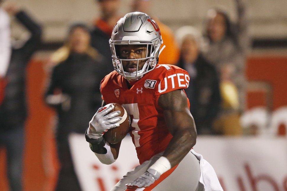 Utah running back Devonta'e Henry-Cole (7) carries the ball against UCLA in the second half during an NCAA college football game Saturday, Nov. 16, 2019, in Salt Lake City. (AP Photo/Rick Bowmer)