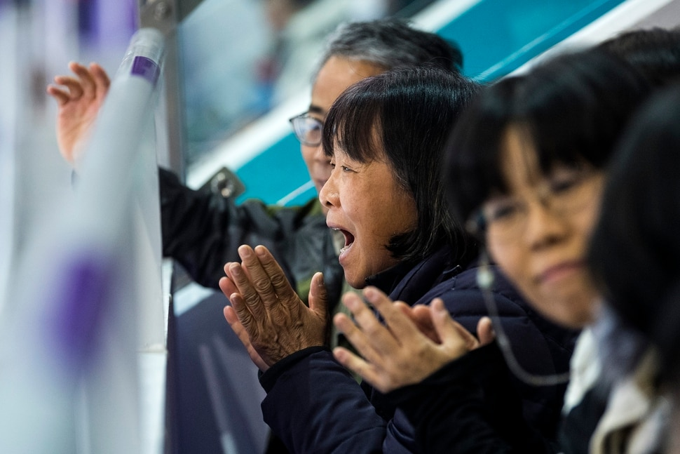 (Chris Detrick | The Salt Lake Tribune) Hetty Wang reacts after watching her son Nathan Chen compete in the Men Single Skating Free Skating at Gangneung Ice Arena during the Pyeongchang 2018 Winter Olympics Saturday, Feb. 17, 2018. Chen landed a record six quadruple jumps, scoring 215.08.