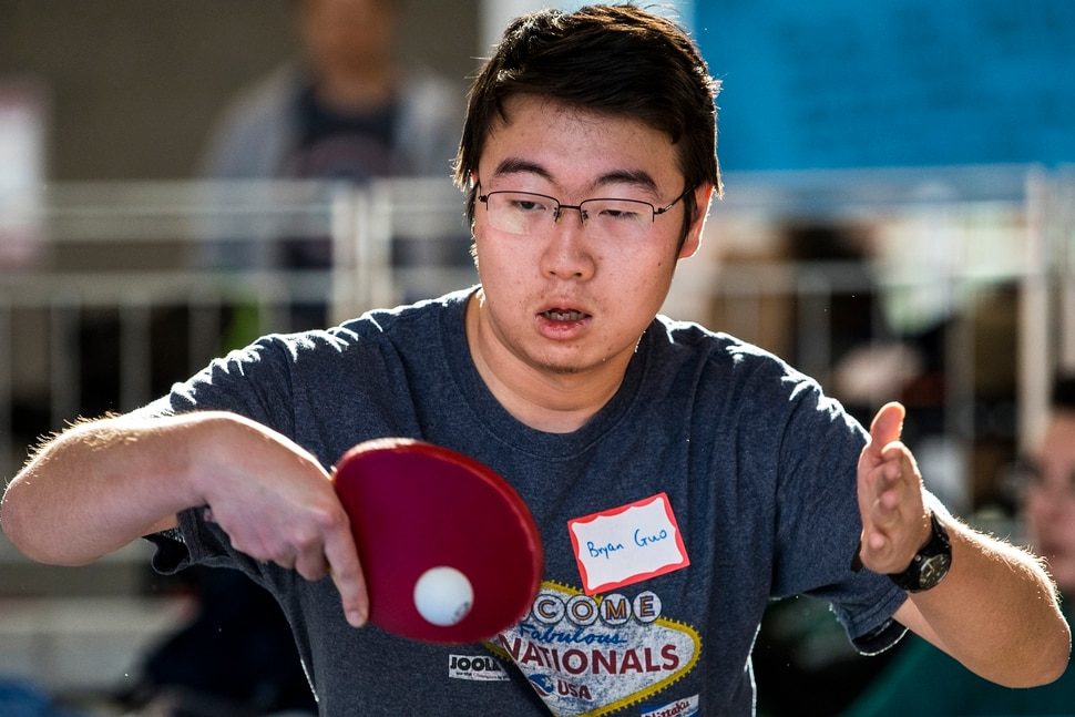 (Chris Detrick | The Salt Lake Tribune) Hillcrest junior Bryan Guo competes during the first state-wide Utah High School Table Tennis Tournament at Granger High School Saturday, January 13, 2018. Organized by math teacher Walter Poelzing and sponsored by Salt Lake City Table Tennis, 46 high school students from all over the state competed. ÒPing Pong is not just a garage game, itÕs a serious sport,Ó said Walter Poelzing, math teacher at Granger High School and organizer of the Invitational. ÒWhen you look internationally, itÕs one of the top sports played around the world, along with soccer. Here in Utah, table tennis is just beginning, but we have a few top national players in our state. WeÕre excited to host this special event; these high school kids are intense, focused and committed to win.Ó Schools participating include Hillcrest, Brighton, Granger, Skyline, Waterford, Syracuse, Cottonwood, American Fork, Bingham,Taylorsville, Itineris Early College High School and Wasatch.