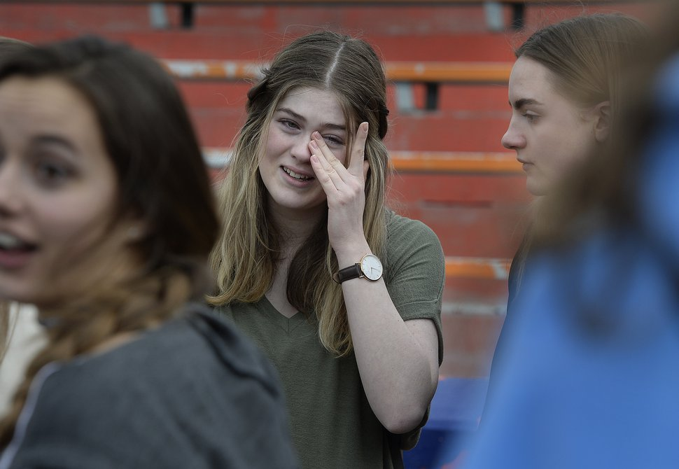 Scott Sommerdorf | The Salt Lake Tribune Meghan Taylor wipes away some tears after she and other students observed a minute of silence for each of the 17 students and staff killed at Marjory Stoneman Douglas High School, during their walkout at Brighton High School, Wednesday, March 14, 2018.