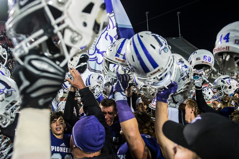 (Chris Detrick | The Salt Lake Tribune) Members of the Lehi football team celebrate after winning the Class 5A state title game at Rice-Eccles Stadium Friday, November 17, 2017. Lehi defeated Skyridge 55-17.