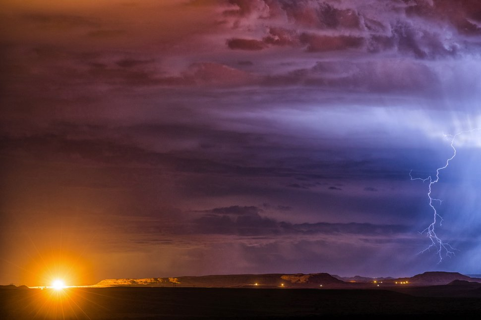(Courtesy of Paul Martini) Bluff-based photographer Paul Martini captured the glare of a natural gas flare (left) near Montezuma Creek during a thunder storm in 2019.
