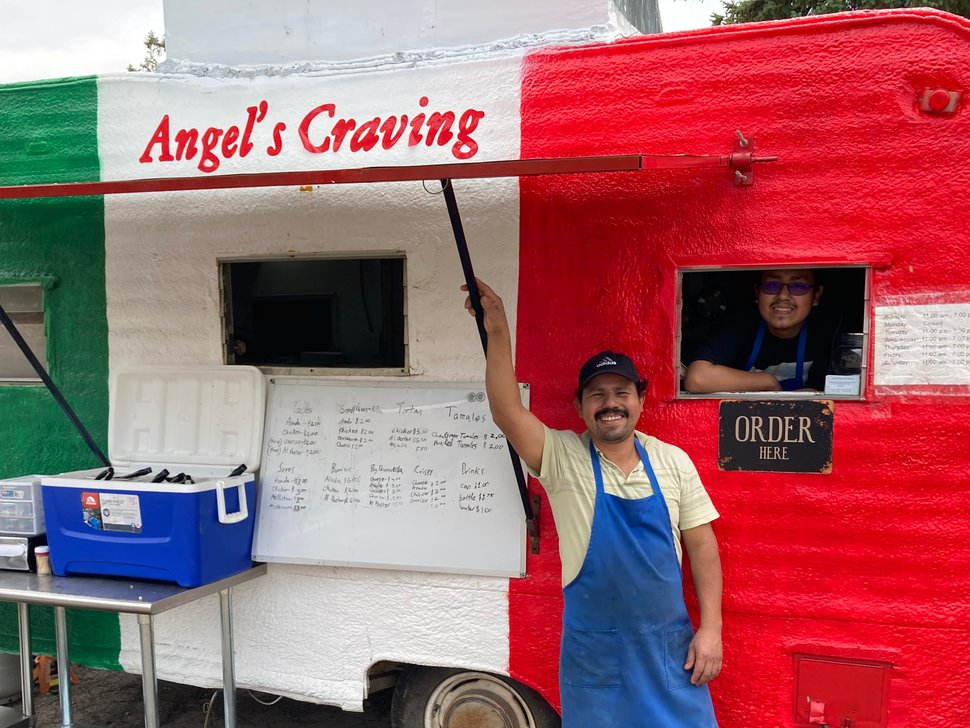 (Leia Larsen | The Salt Lake Tribune) Angel Villa, left, and his son, also named Angel, sell tacos on June 13, 2020. In addition to his taco business, Villa is a part-owner of the Riverside Motel, which has seen a significant decrease in reservations due to the pandemic. Villa is using the downtime to remodel rooms in the motel.