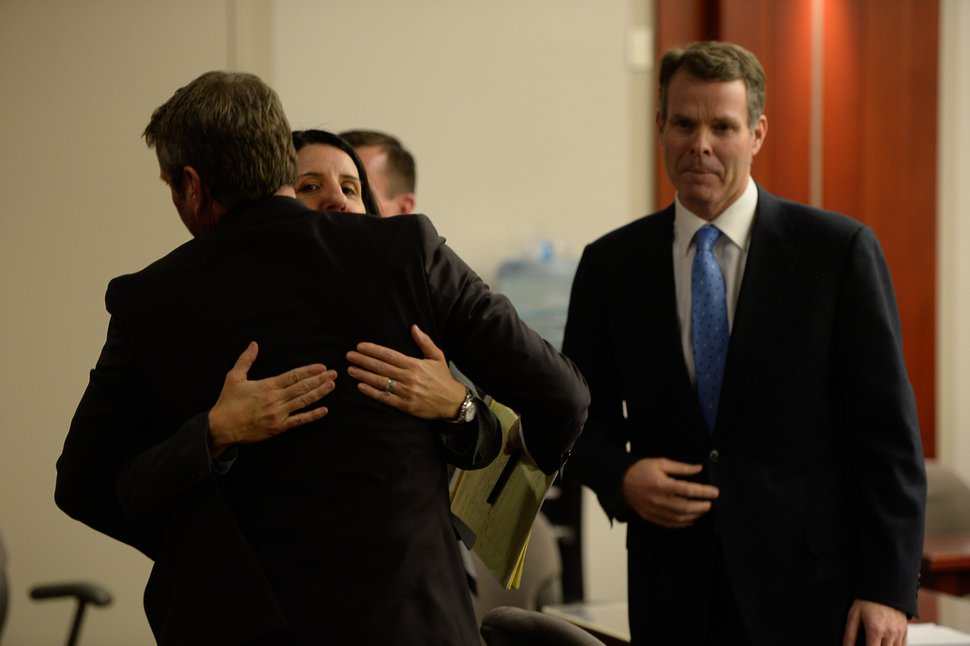Francisco Kjolseth | The Salt Lake Tribune Defense attorney's Cara Tangaro and Scott C. Williams embrace as former Utah Attorney General John Swallow right, had just found out he was cleared of all charges during his public-corruption trial in Salt Lake City, Thursday March 2, 2017.