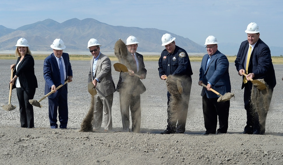 (Scott Sommerdorf | The Salt Lake Tribune) Utah Governor Gary Herbert, center, turns dirt along with other dignitaries at the site of the new prison, Wednesday, August 16, 2017. Rep. Brad Wilson, R-Layton, is left of the Governor, and Utah Dept. of Corrections Executive Director Rollin Cook is to the right.