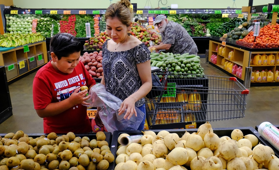 (Francisco Kjolseth   The Salt Lake Tribune) Helizandro Mojica, 11, helps his mother Teresa Sotelo picking out fruits and vegetables on Wed. June 20, 2018, at Rancho Market at North Temple and 900 West, a chain that started in 2006 and now has 10 stores. The owner says half of their shoppers are Latino, and it caters to other immigrant groups and long-time residents. New Census numbers show a continuing growth of minorities in Utah. Minorities have grown by 132k since the 2010 Census in Utah, and the Latino population has grown by 76k since then.