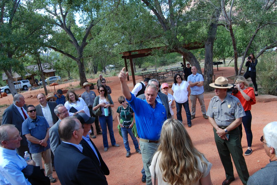 (Brian Maffly | The Salt Lake Tribune) Interior Secretary Ryan Zinke, center in blue shirt, inspects a renovated loop of the Watchman Campground during a tour Zion National Park on Monday, Sept. 24, 2018. Zinke was in Utah promoting bipartisan legislation to address the National Park Service's $12 billion maintenance backlog.