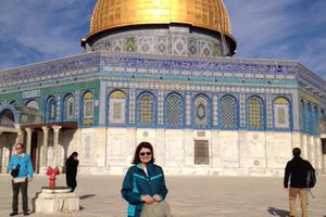 (Courtesy Episcopal Diocese of Utah) The Rev. Mary June Nestler, during a recent visit to Jerusalem, stands before the famous Dome of the Rock mosque.