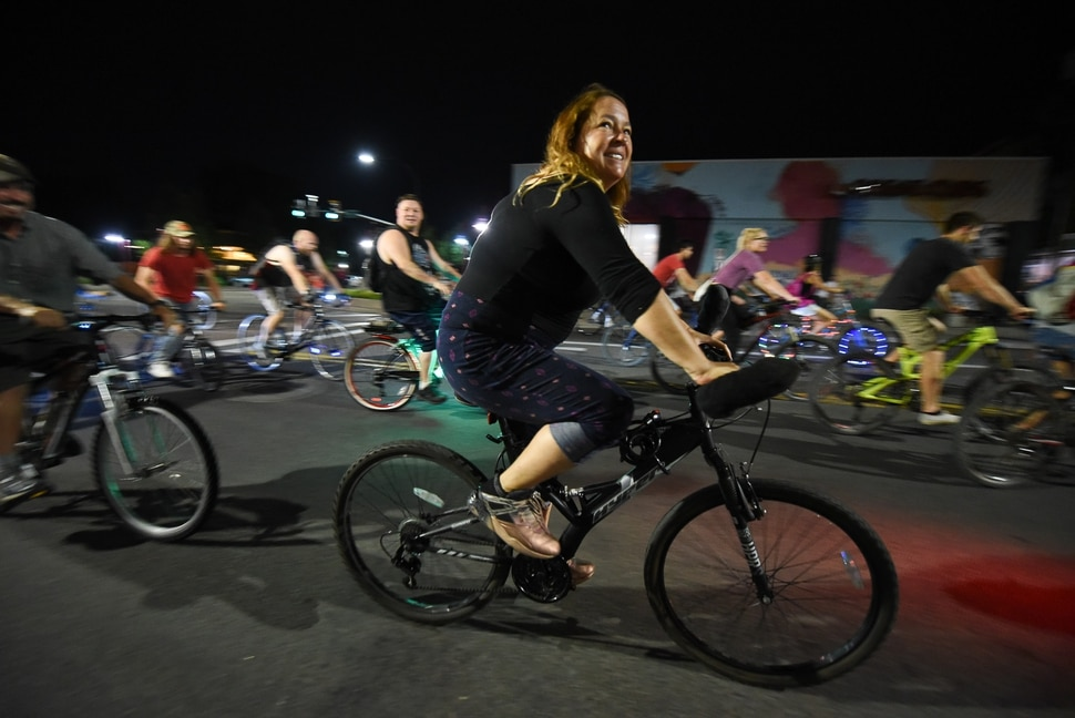 (Francisco Kjolseth | The Salt Lake Tribune) A large group of cyclist begins their ride from the corner of 9th and 9th after gathering after 9pm in Salt Lake City on Thursday, July 26, 2018, for the weekly ride that has become known as the 999 Ride. The inclusive, all-welcoming slow casual social ride happens year round on Thursday nights, with riders often pedaling into the early morning hours. Newly released video shows rider Cameron Hooyer being struck and killed by a FrontRunner train at a downtown railroad crossing during last weeks ride when the 22-year-old failed to stop or heed the warning signals before crossing the tracks during the group ride.