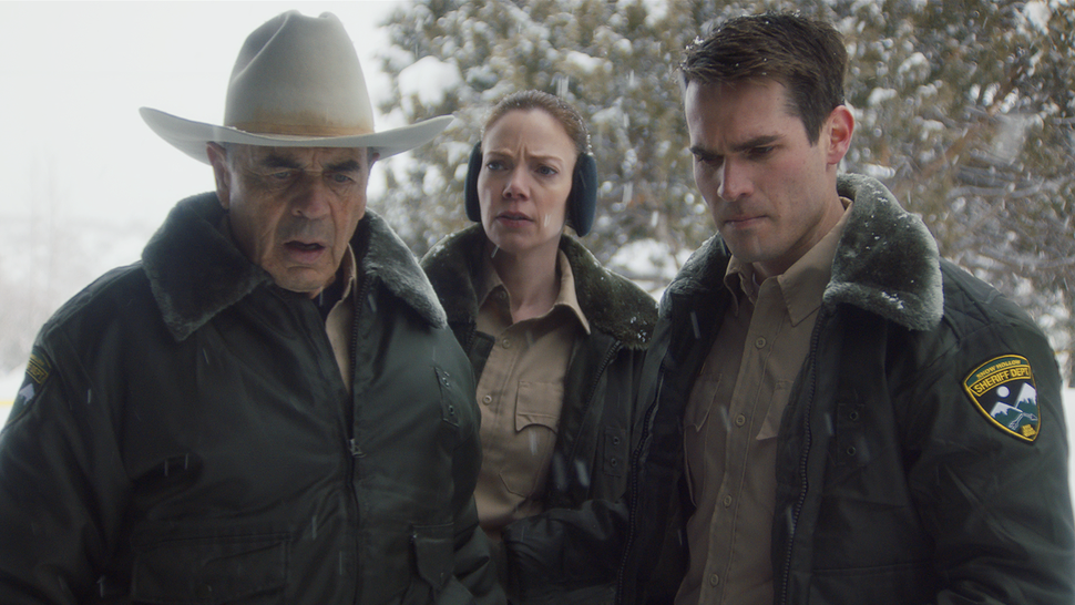 (Photo courtesy of Orion Classics) Sheriff Hadley (Robert Forster, left), along with deputies Julia Robson (Riki Lindhome, center) and John Marshall (Jim Cummings) look at a bloody murder scene, in the filmed-in-Utah horror thriller The Wolf of Snow Hollow.