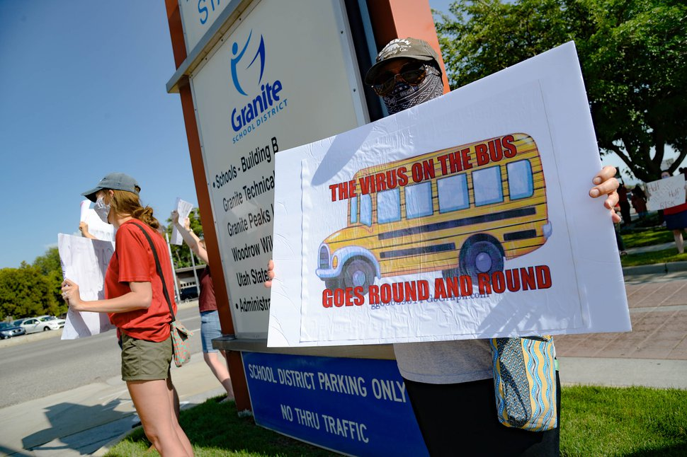 (Francisco Kjolseth | Tribune file photo) Hundreds of Granite School district teachers gather at the Granite School District office on Tuesday, Aug. 4, 2020, to protest the district's plans for reopening, which will allow students back into the classroom, like normal, five days a week.
