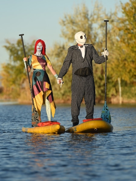 (Francisco Kjolseth | The Salt Lake Tribune) Stand up paddle board enthusiasts Roxy Christensen and Chris Knoles take to the water at Bountiful Pond on Tuesday, Oct. 30, 2018, in what has become a Halloween tradition for the 4th year in a row as they dressed up this year as Jack and Sally Skellington from the movie Nightmare Before Christmas. We paddle year round but actually paddle more in the winter, exclaimed Knoles, who carry the tradition on at Christmas, dressing up in something festive and paddling on the Great Salt Lake where the high salinity usually keeps the water from freezing.