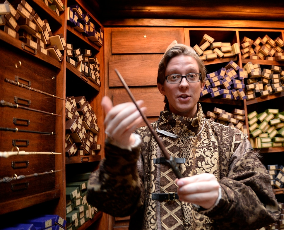 (Al Hartmann | The Salt Lake Tribune) Deven Skaggs, wand apprentice describes the qualities of Harry Potter's wand inside Ollivander's wand shop at Warner Bros. Harry Potter-themed exhibit and shopping area in the Shops at South Town in Sandy. There are interactive activities in addition to Harry Potter and Fantastic Beasts merchandise.