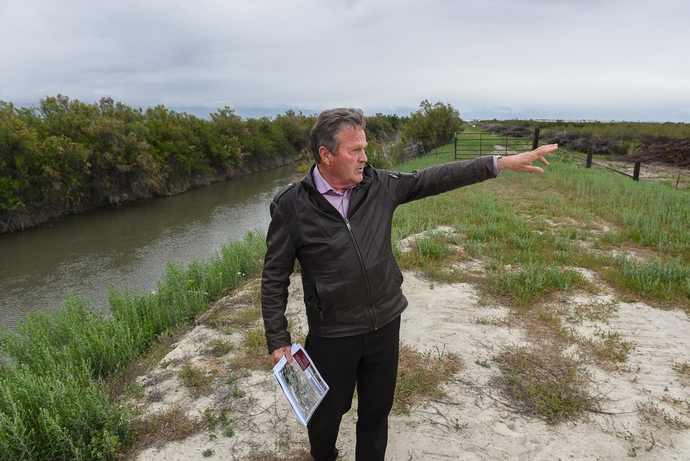 Francisco Kjolseth | The Salt Lake Tribune Co-chairman of the prison commission, Sen. Jerry Stevenson, points out the general direction of one of the five prison sites under consideration, west of Salt Lake City near Interstate 80 and 7200 West.