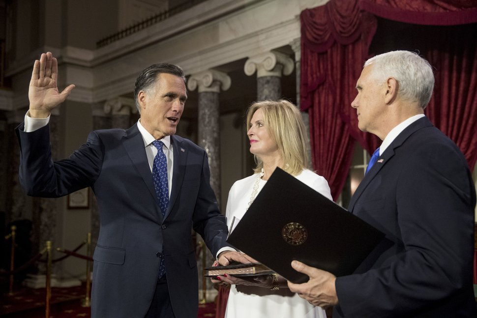 (AP Photo/Andrew Harnik) Vice President Mike Pence administers the Senate oath of office to Sen. Mitt Romney, R-Utah, accompanied by his wife, Ann, during a mock swearing-in ceremony in the Old Senate Chamber on Capitol Hill in Washington, Thursday, Jan. 3, 2019.