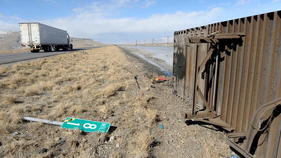(Al Hartmann | The Salt Lake Tribune) One of three semi truck trailers that flipped over on I-80 westbound in high winds around 8:00 a.m. Friday March 2. The incidents happened between mile posts 79 to 82 just east of the Rowley-Dugway exit in Tooele County. Wrecking crews were kept busy all morning righting the rigs.