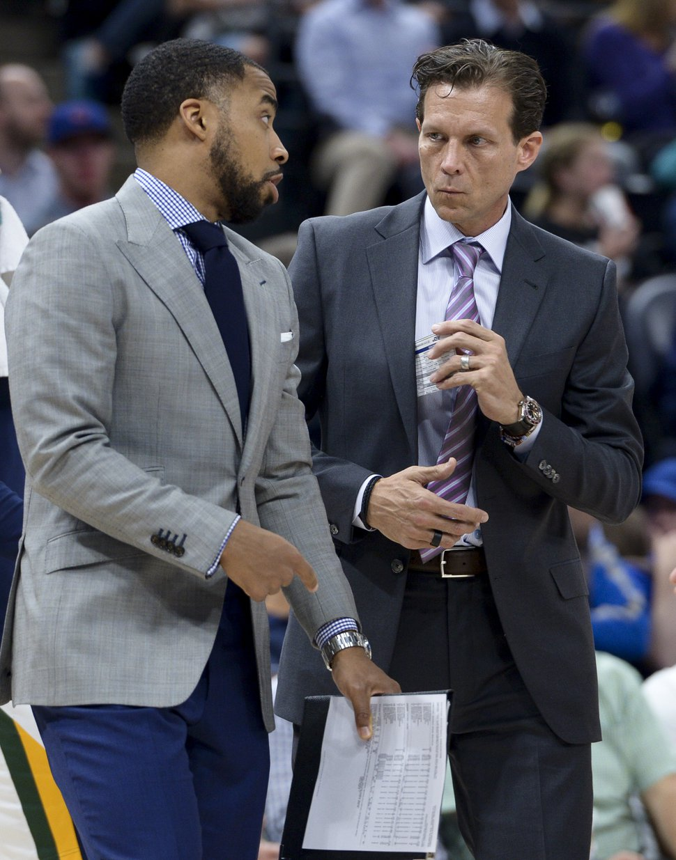 (Leah Hogsten | The Salt Lake Tribune) Utah Jazz assistant coach Johnnie Bryant talks strategy with head coach Quin Snyder during a time out against the Golden State Warriors , Tuesday, April 10, 2018 at the Vivint Smart Home Arena.