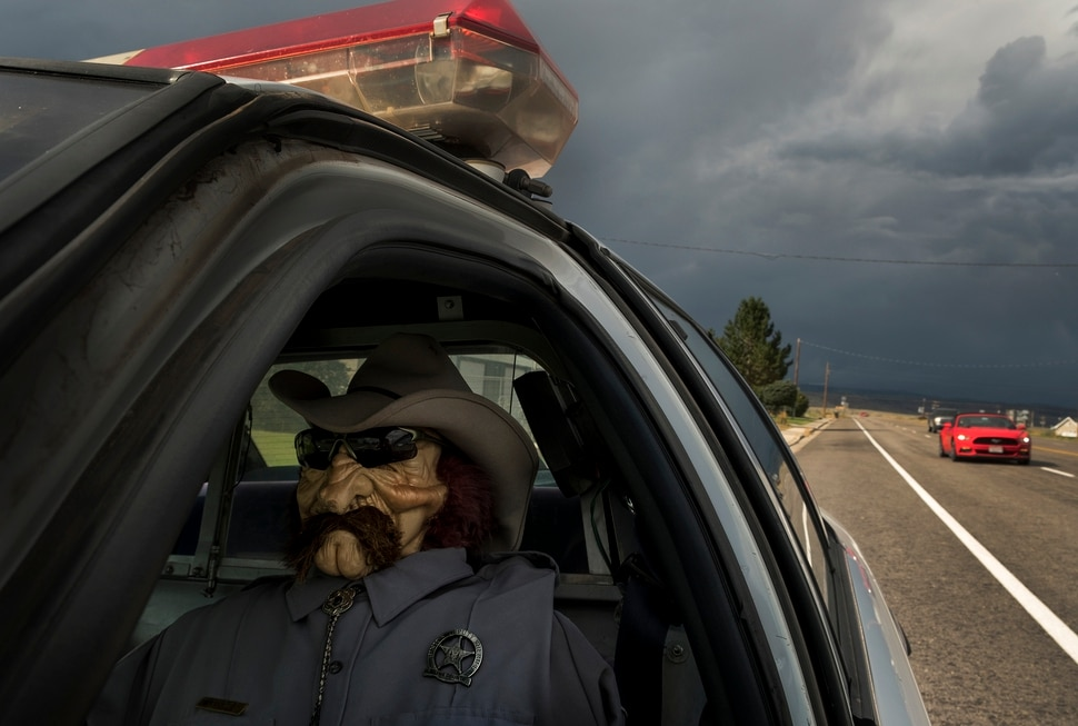 (Leah Hogsten | The Salt Lake Tribune) Parked on the shoulder of Highway 24, Wayne County sheriff's deputy Parker Doolittle deters would be speeders in the small town of Loa, Utah, Sept. 13, 2017.