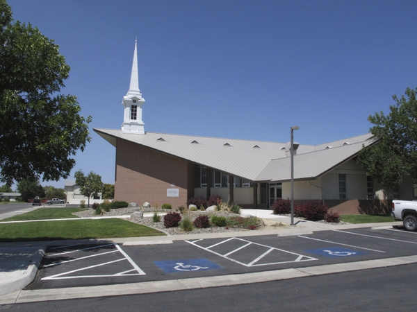 (AP Photo/Scott Sonner) The Mormon church where a longtime rural Nevada volunteer firefighter was fatally shot during Sunday services the day before is pictured in this photo taken Monday, July 23, 2018, in Fallon, Nev., about 60 miles east of Reno.