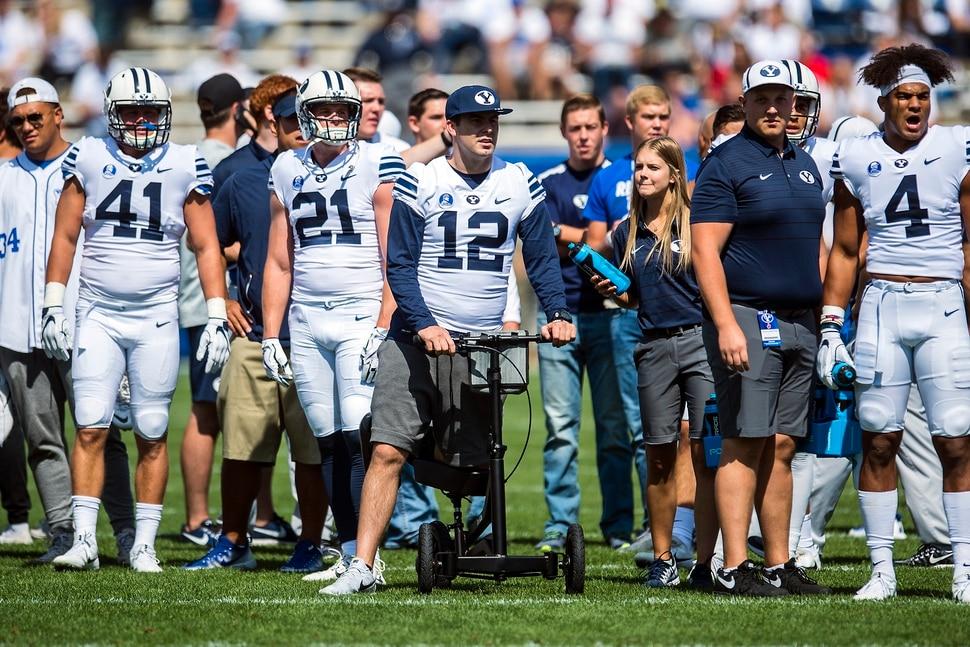 (Chris Detrick | The Salt Lake Tribune) Brigham Young Cougars quarterback Tanner Mangum (12) watches practice before the game at LaVell Edwards Stadium Saturday Saturday, September 16, 2017.