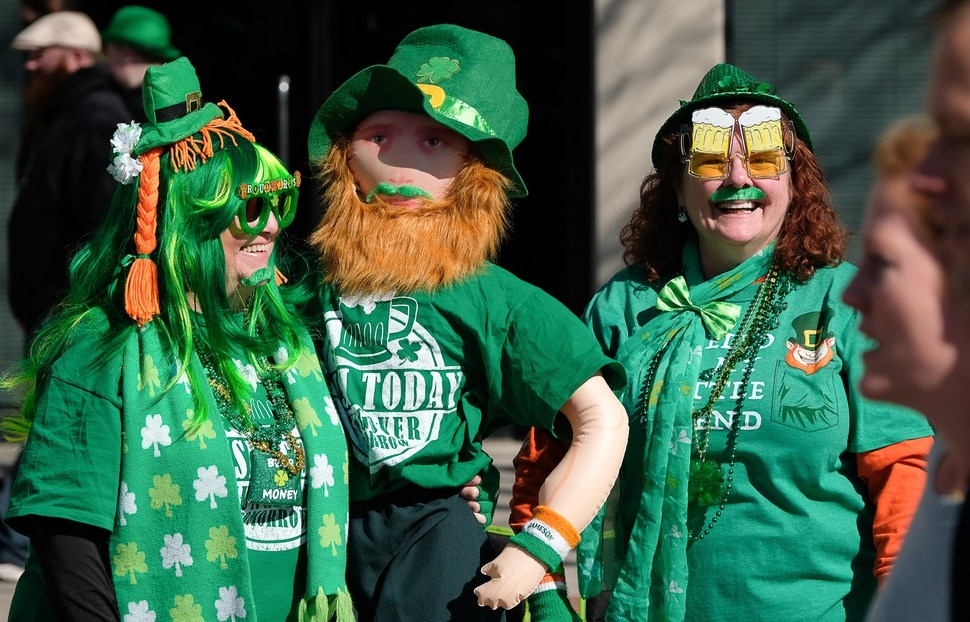 (Francisco Kjolseth | The Salt Lake Tribune) Terrie Orton, left, and JoAnn Langenegger join the fun from the sidelines as Salt Lake CityÕs Irish community celebrates their 41st annual St. PatrickÕs Day Parade with crowds lining up to take in the festivities. Marching bands, Irish dancers, bagpipes and a sea of green moved along 200 South, starting at 500 East Saturday morning en route to State street where the Siamsa festivities kept the fun going at the Gallivan Center.