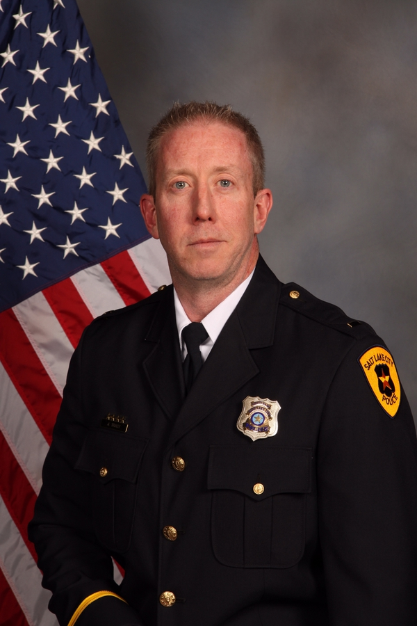This image provided by the Salt Lake City police department shows Lt. James Tracy. Detective Jeff Payne, a Utah police officer who was caught on video roughly handcuffing a nurse because she refused to allow a blood draw, was fired Tuesday, Oct. 10, 2017, in a case that became a flashpoint in the ongoing national conversation about police use of force. Payne's supervisor, Tracy, was demoted to officer. (Salt Lake City Police, via AP)