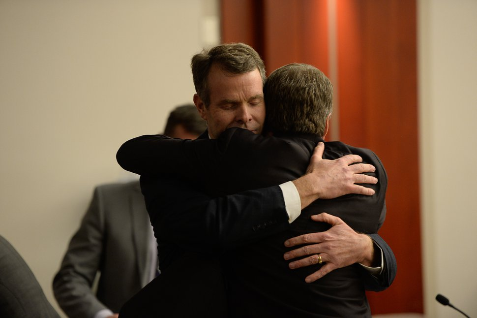 Francisco Kjolseth | The Salt Lake Tribune Former Utah Attorney General John Swallow hugs defense attorney Scott C. Williams after he was cleared of all charges during his public-corruption trial in Salt Lake City, Thursday March 2, 2017.
