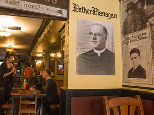 Leah Hogsten  |  The Salt Lake Tribune l-r Photos of Father E.J. Flanagan and Charles Kenworthy, owner John Kenworthy's grandfather, adorn the walls at Flanigan's on Main. The Park City pub is one of several restaurants and bars that will temporarily close now that the ski season has ended.